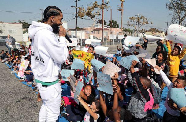 PHOTO: Rapper Nipsey Hussle speaks to kids after the opening of a basketball court, Oct. 22, 2018 in Los Angeles. Hussle partnered with Puma to refurbish the elementary school basketball court in south Los Angeles near where Nipsey grew up. (Jerritt Clark/Getty Images, FILE)