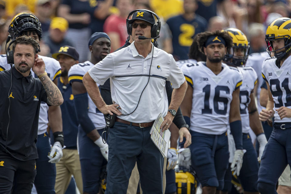 Michigan Wolverines coach Jim Harbaugh watches on during a college football game against Wisconsin Badgers on Oct. 2, 2021. (Dan Sanger/Icon Sportswire via Getty Images)