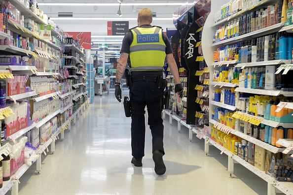 A police officer shops during hours designated for prioritizing health care and emergency workers at a Coles Supermarket in Melbourne.