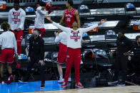 Ohio State guard Eugene Brown III (3) celebrates a basket on the bench in the second half of an NCAA college basketball against Michigan game at the Big Ten Conference tournament in Indianapolis, Saturday, March 13, 2021. Ohio State defeated Michigan 68-67. (AP Photo/Michael Conroy)