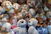 "Valeria Schmidt, nicknamed as ""Teddy Bear Mama"", hugs teddy bears in Harsany"