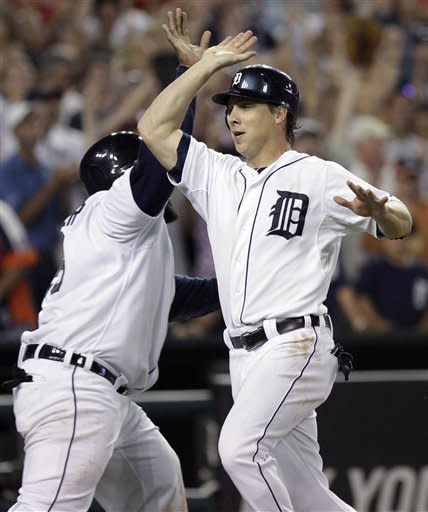 Detroit Tigers' Andy Dirks, right, celebrates with Prince Fielder after scoring on a double by Jhonny Peralta in the eighth inning of a baseball game against the Los Angeles Angels on Saturday, Aug. 25, 2012, in Detroit. The Tigers defeated the Angels 5-3. (AP Photo/Duane Burleson)