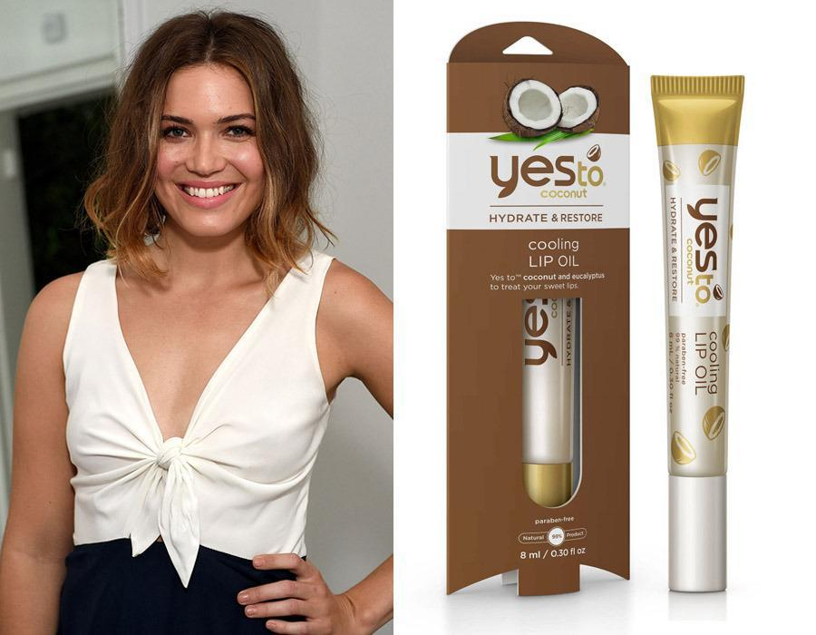 "<p>After enjoying some sun, Mandy Moore applies <a href=""http://www.yestocarrots.com/product/yes-to-coconut-cooling-lip-oil?product_id=5117101"" rel=""nofollow noopener"" target=""_blank"" data-ylk=""slk:Yes to Coconut Cooling Lip Oil"" class=""link rapid-noclick-resp"">Yes to Coconut Cooling Lip Oil</a> ($4.99) to soothe her lips without the gummy texture some ultra-hydrating balms leave behind. The songstress says she loves that it's paraben-free and 99 percent natural.</p><p><i>(Photo: Getty Images/Yes to Carrots)</i><br></p>"