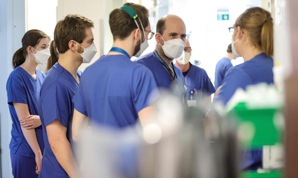 <p>NHS staff are being expected to work extra hours unpaid</p> (EPA)