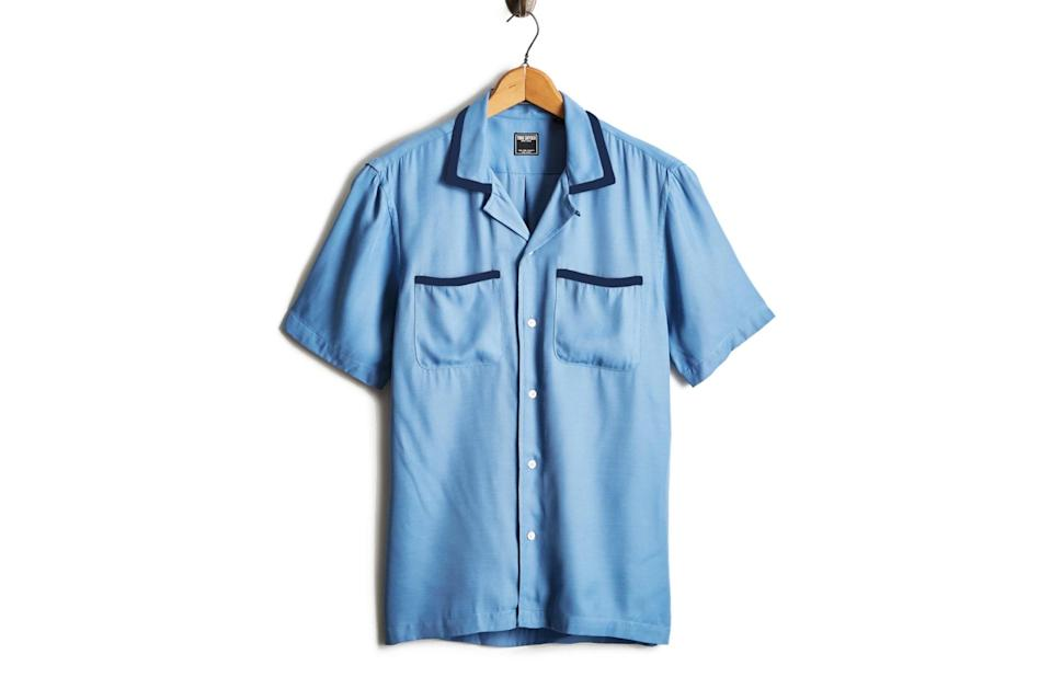 """$178, Todd Snyder. <a href=""""https://www.toddsnyder.com/collections/sale/products/tipped-bowling-shirt-blue"""" rel=""""nofollow noopener"""" target=""""_blank"""" data-ylk=""""slk:Get it now!"""" class=""""link rapid-noclick-resp"""">Get it now!</a>"""