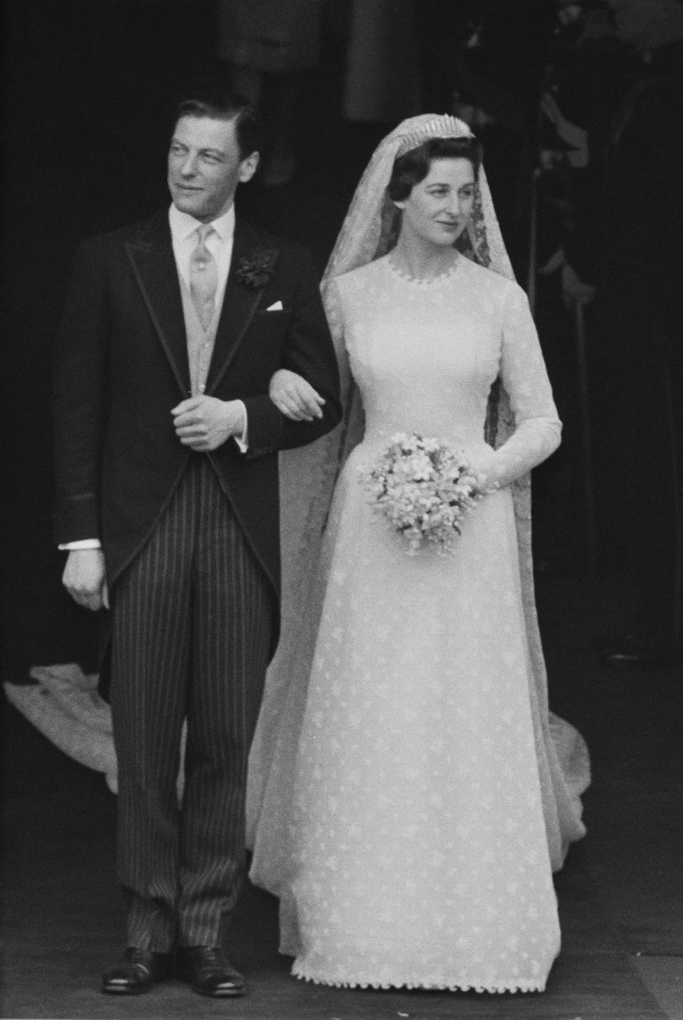 Princess Alexandra, The Honourable Lady Ogilvy pictured with her husband Angus Ogilvy (1928-2004) as they leave Westminster Abbey on the day of their wedding in London on 24th April 1963. (Photo by Harry Benson/Daily Express/Hulton Archive/Getty Images)