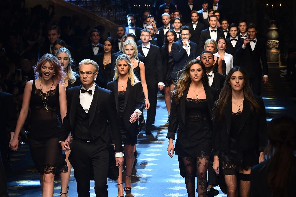 First row (L-R) Pyper America Smith, Brandon Lee, Sophia and Sistine Stallone present creations for fashion house Dolce Gabbana (AFP Photo/GIUSEPPE CACACE                     )