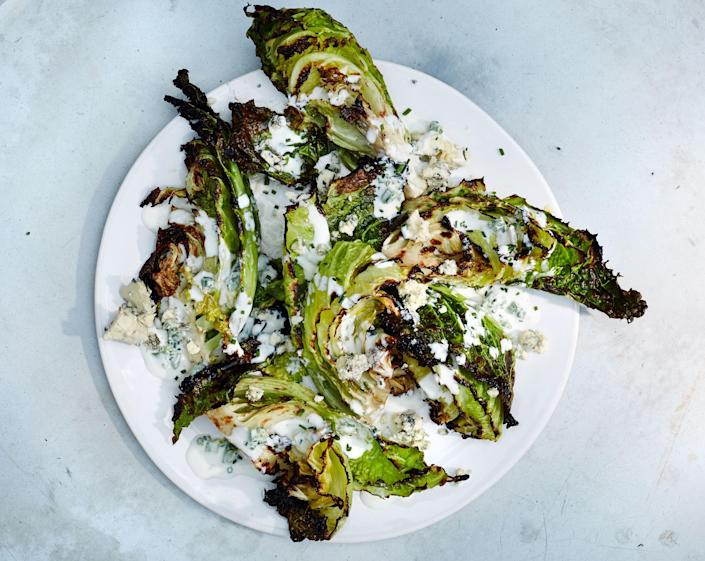 """To take this to a traditional wedge salad place, grill some thick-cut bacon and crumble it over the top. <a href=""""https://www.bonappetit.com/recipe/savoy-cabbage-wedges-with-buttermilk-dressing?mbid=synd_yahoo_rss"""" rel=""""nofollow noopener"""" target=""""_blank"""" data-ylk=""""slk:See recipe."""" class=""""link rapid-noclick-resp"""">See recipe.</a>"""