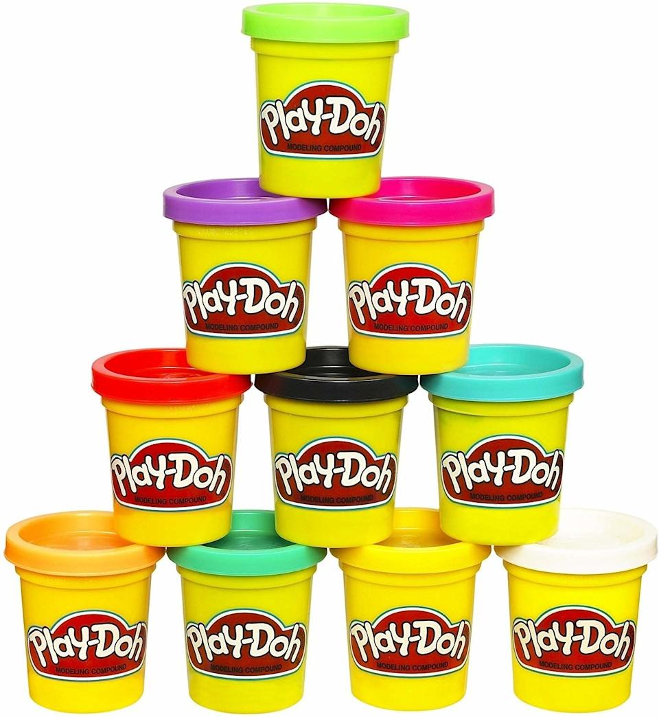 """It's all nontoxic, nonirritating, nonallergenic and the packaging is recyclable. But, yeah, it still smells like Play-Doh.<br /><br /><strong>Promising review:</strong>""""Colorful, nontoxic Play-Doh has been great for my son who has many allergies including skin allergies. He has had no problem with these.<strong>This keeps him occupied for quite some time, often when I am cooking or cleaning.</strong>I played with this as a child myself and have fond memories of it."""" —<a href=""""https://amzn.to/3tHH63L"""" target=""""_blank"""" rel=""""noopener noreferrer"""">Brandy P.</a><br /><strong><br />Get it from Amazon for<a href=""""https://amzn.to/3v3HY2S"""" target=""""_blank"""" rel=""""noopener noreferrer"""">$7.99.</a></strong>"""