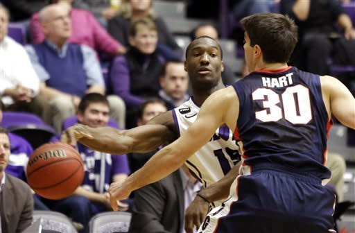 Portland guard Derrick Rodgers, left, passes against pressure from Gonzaga guard Michael Hart during the first half of an NCAA college basketball game in Portland, Ore., Thursday, Jan. 17, 2013. (AP Photo/Don Ryan)
