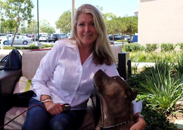 Architect turned Democratic candidate Laura Oatman and her dog Gracie at a café near her home in Newport Beach, Calif. (Photo: Andrew Romano/Yahoo News)