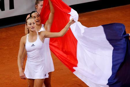 Tennis - Fed Cup - World Group Semi-Final - France v Romania - Kindarena, Rouen, France - April 21, 2019 France's Kristina Mladenovic and Caroline Garcia celebrate victory in the semi-final REUTERS/Charles Platiau