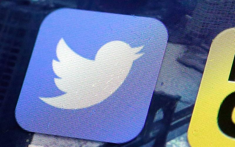 A Twitter app tile on a mobile phone screen - Credit: Richard Drew/AP Photo