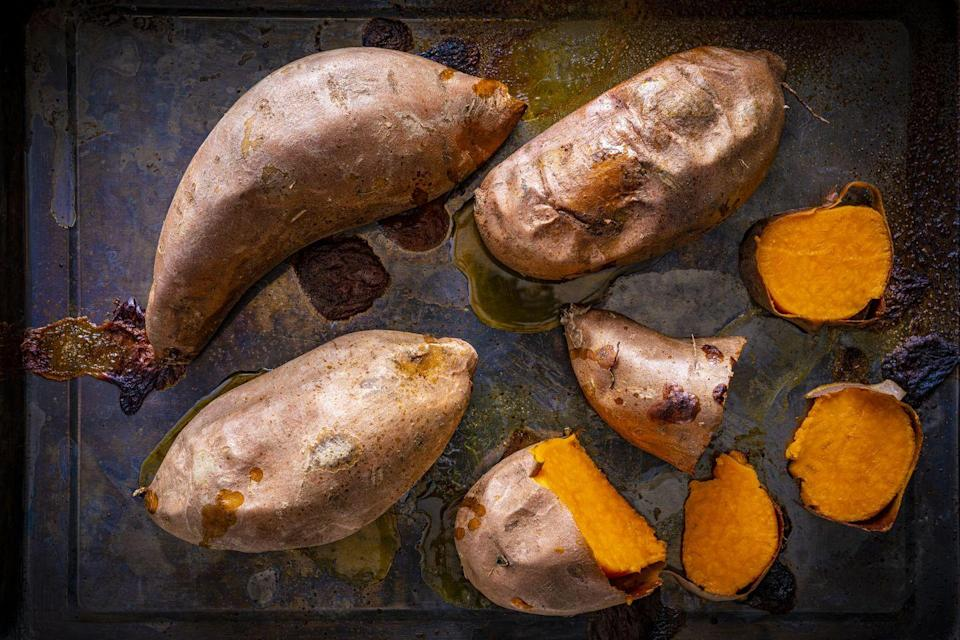<p>If you're looking for a Whole30-compliant method to spruce up a sweet potato, consider turning into into a makeshift taco. Sauté ground beef with minced garlic and onion, says Cavuto, then season it with salt, pepper, dried oregano, and cumin. Then you can stuff that meat inside of a baked sweet potato, and top it with avocado and chopped tomato. </p>