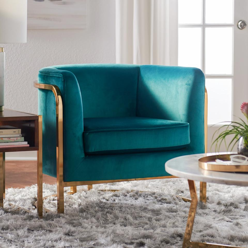 """<p>This velvet <a href=""""https://www.popsugar.com/buy/MoDRN-Marni-Barrel-Accent-Chair-491483?p_name=MoDRN%20Marni%20Barrel%20Accent%20Chair&retailer=walmart.com&pid=491483&price=349&evar1=casa%3Aus&evar9=45825160&evar98=https%3A%2F%2Fwww.popsugar.com%2Fphoto-gallery%2F45825160%2Fimage%2F45825387%2FMoDRN-Marni-Barrel-Accent-Chair&list1=shopping%2Chome%20decor%2Cfurniture%2Cwalmart%2Chome%20shopping&prop13=api&pdata=1"""" rel=""""nofollow"""" data-shoppable-link=""""1"""" target=""""_blank"""" class=""""ga-track"""" data-ga-category=""""Related"""" data-ga-label=""""https://www.walmart.com/ip/MoDRN-Marni-Barrel-Accent-Chair-Multiple-Colors/444953260?selected=true"""" data-ga-action=""""In-Line Links"""">MoDRN Marni Barrel Accent Chair</a> ($349) will look so pretty next to your sofa or in your bedroom. Honestly, we'll find any excuse to have it in our lives.</p>"""