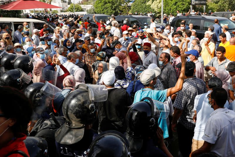 Tunisians gather after president ousts government, in Tunis