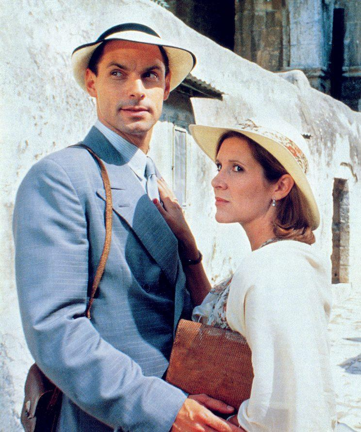 <p>Fisher, pictured here with Nicholas Guest in 1988, played a role in this Agatha Christie film. (Photo: Everett Collection)</p>
