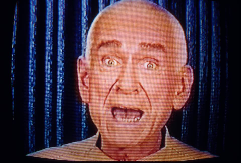 Marshall Herff Applewhite, founder and co-leader of the religious cult Heaven's Gate, speaks to his followers via television. (Photo by Brooks Kraft LLC/Sygma via Getty Images)