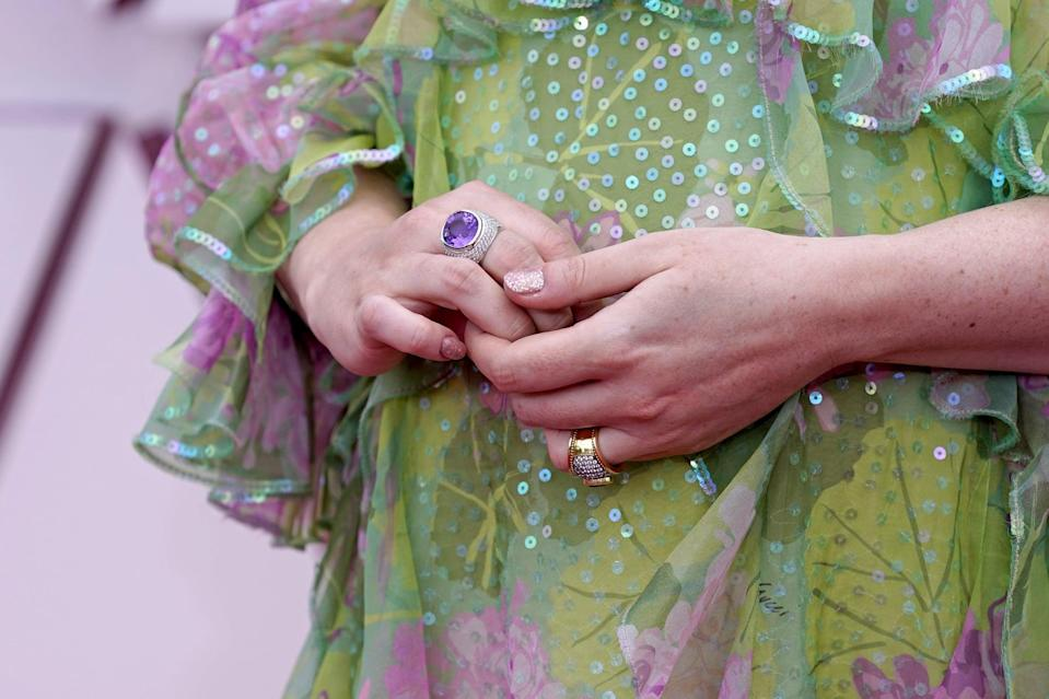 "<p>Emerald Fennell matched her dress with her nails by wearing a solid rosy pink glitter hue painted by manicurist <a href=""https://www.instagram.com/nails_by_yoko/"" class=""link rapid-noclick-resp"" rel=""nofollow noopener"" target=""_blank"" data-ylk=""slk:Yoko Sakakura"">Yoko Sakakura</a>. We'll never get tired of glitter nail polish, especially when it's this sparkly.</p>"