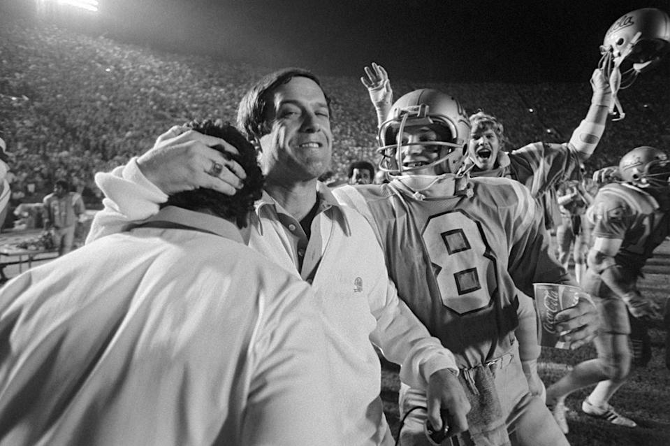 UCLA coach Terry Donohue embraces a sideline companion during a game against USC on Nov. 26, 1977.