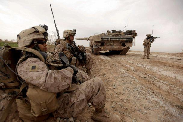 PHOTO: US marines with 1/3 marine Charlie Company patrol past a Danish army Leopard 2A5EK tank as they clear Improvised Explosive Device (IED)s from a main route in Trikh Nawar on the North Eastern outskirts of Marjah, Afghanistan, February 21, 2010. (Patrick Baz/AFP via Getty Images, FILE)