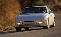 """<p>If Porsche's 944 Turbo doesn't have the otherworldly appeal of the German firm's 959 supercar or the nonchalant cool of Hank Moody's 964 Cabriolet, it's still damn special. Porsche fitted all three of its front-engined cars of this era—944, 928, 924—with a transaxle for better weight distribution and handling, a practice adopted a decade later by the Chevrolet Corvette. </p><p>For gearheads, that layout was cool enough, but starting in 1985 Porsche offered 944 buyers the option of a turbocharged version of the 2.5-liter inline-four, which was essentially half of a 928's 5.0-liter V-8. It made 217 horsepower in base form, rising to 247 in Turbo S guise in 1988. The latter model's KKK turbo huffed with 11.7 psi of boost, enabling mid-five-second sprints to 60 mph and quarter-mile elapsed times in the 13s. We summed up the car in our June 1988 test thusly: """"You'll have a hard time finding a GT machine as easy to drive fast and as easy to live with as a 944 Turbo S."""" That's all the cool we'll ever need. <em>—K.C. Colwell</em></p>"""
