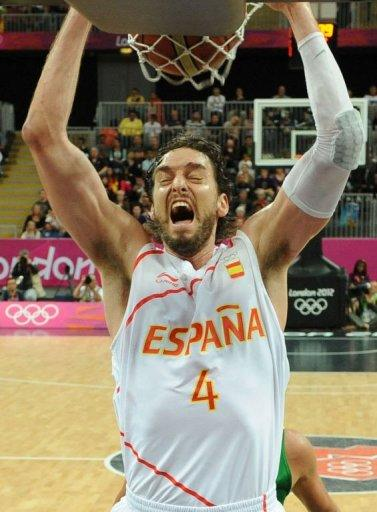Spanish forward Pau Gasol scores during the men's basketball preliminary round match Spain vs Brazil as part of the London 2012 Olympic Games at the Basketball Arena in London. Brazil defeated Spain 88-82