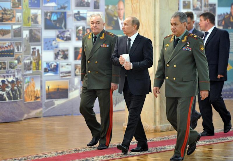 "Russian President Vladimir Putin, second left, and Defense Minister Sergei Shoigu, right, walk to meet senior military officials in Moscow on Wednesday, Feb. 27, 2013. Russian President Vladimir Putin has called on the country's top brass to deliver a drastic upgrade of the armed forces in the next three years to fend off attempts from abroad to ""tip the strategic balance"" in the world. (AP Photo/RIA Novosti, Alexei Nikolsky, Presidential Press Service)"
