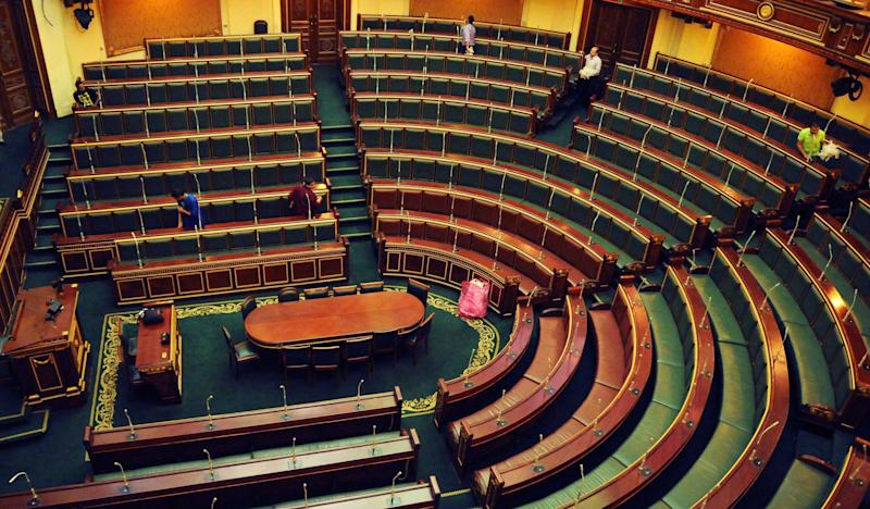 Workers clean inside the Egyptian parliament in Cairo, Egypt, Monday, July 9, 2012. The speaker of Egypt's Islamist-dominated parliament called Monday for the legislature to meet this week, raising the stakes in a tense standoff with the powerful military which backed a court ruling to dissolve the chamber. (AP Photo/Mohammed Asad)