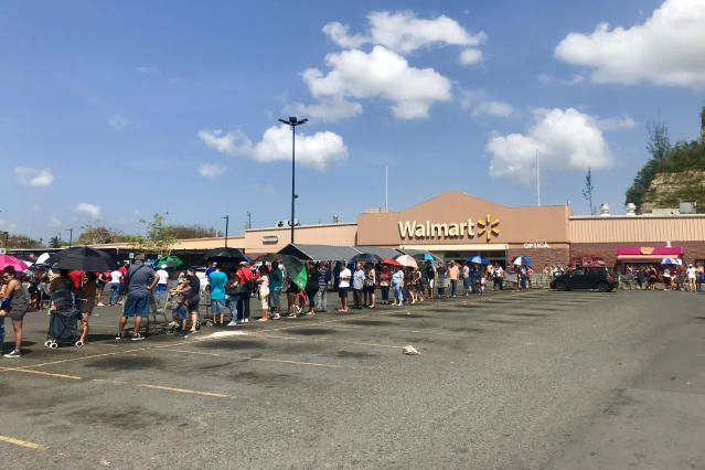 <p>Hundreds of people wait in line for hours at the Walmart in Bayamon, Puerto Rico on Sunday Oct. 8, 2017. (Photo: Caitlin Dickson/Yahoo News) </p>