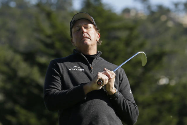 Phil Mickelson reacts after missing a birdie putt on the third green of the Pebble Beach Golf Links during the final round of the AT&T Pebble Beach National Pro-Am golf tournament Sunday, Feb. 9, 2020, in Pebble Beach, Calif. (AP Photo/Eric Risberg)