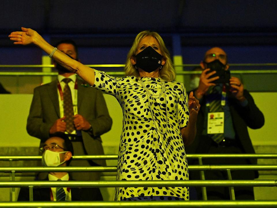 First Lady Jill Biden wearing a protective face mask reacts as the U.S. contingent enters the stadium during the opening ceremony. (REUTERS)