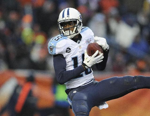 Tennessee Titans wide receiver Justin Hunter hails in a touchdown past during the second half of an NFL football game against the Denver Broncos on Sunday, Dec. 8, 2013, in Denver. (AP Photo/Chris Schneider)