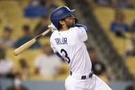 Los Angeles Dodgers' Chris Taylor watches his solo home run during the fifth inning of a baseball game against the Philadelphia Phillies in Los Angeles, Monday, June 14, 2021. (AP Photo/Kyusung Gong)