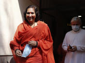 Hindu hardliner Sadhvi Ritambhara, an accused in the 1992 attack and demolition of a 16th century mosque, leaves for a court in Lucknow, India, Wednesday, Sept. 30, 2020. An Indian court on Wednesday acquitted all 32 accused, including four senior leaders of the ruling Hindu nationalist Bharatiya Janata Party, in the case. The demolition sparked Hindu-Muslim violence that left some 2,000 people dead. (AP Photo/Rajesh Kumar Singh)