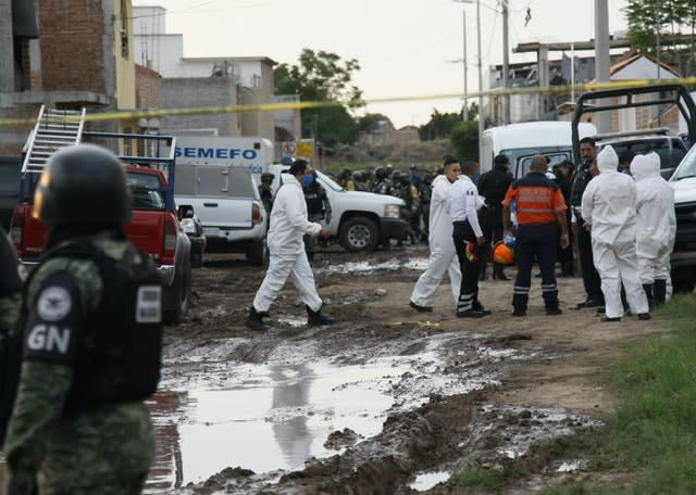 National Guard and forensic investigators at the scene of a mass shooting in Mexico