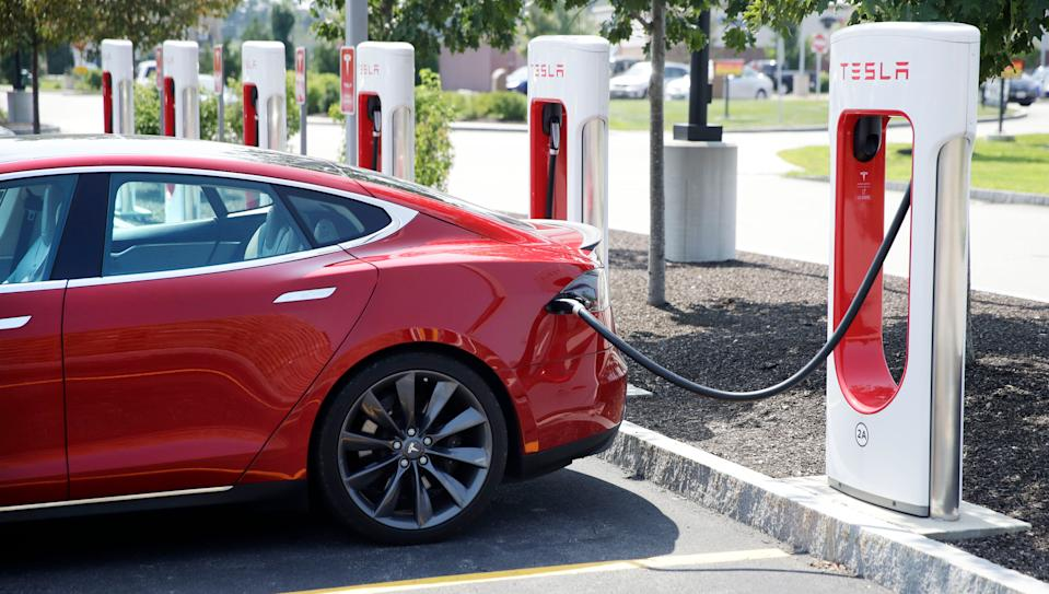 A Tesla Model S is plugged in at a vehicle Supercharging station in Seabrook, N.H., Friday, Aug. 24, 2018. (AP Photo/Charles Krupa)