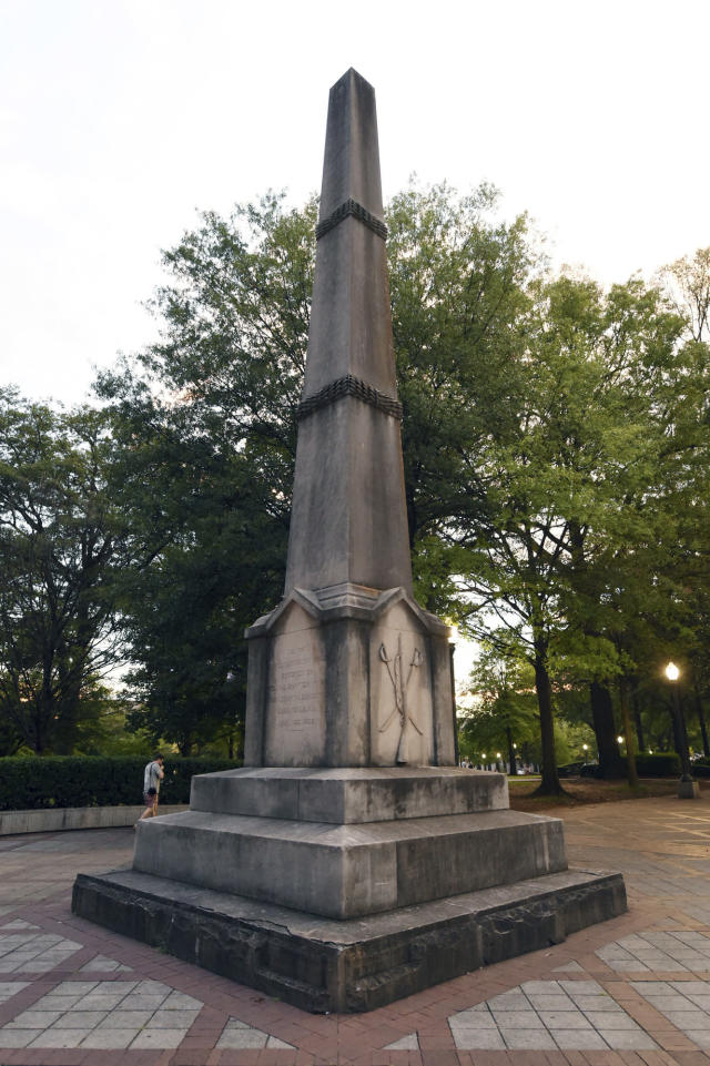 <p>A man walks past the Confederate Monument in Birmingham, Ala. on Tuesday, Aug. 15, 2017. The city's Mayor William Bell ordered Birmingham city workers to cover the monument in Linn Park. (Photo: Joe Songer /AL.com via AP) </p>
