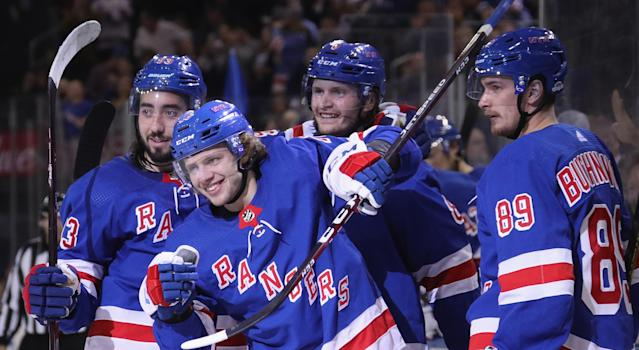 """Artemi Panarin celebrates his first goal with the <a class=""""link rapid-noclick-resp"""" href=""""/nhl/teams/ny-rangers/"""" data-ylk=""""slk:New York Rangers"""">New York Rangers</a> alongside Mika Zibanejad, Jacob Trouba and Pavel Buchnevich during the second period against the <a class=""""link rapid-noclick-resp"""" href=""""/nhl/teams/winnipeg/"""" data-ylk=""""slk:Winnipeg Jets"""">Winnipeg Jets</a> at Madison Square Garden on October 03, 2019 in New York City. (Photo by Bruce Bennett/Getty Images)"""