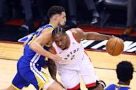 Kawhi Leonard #2 of the Toronto Raptors is defended by Klay Thompson #11 of the Golden State Warriors in the first quarter during Game One of the 2019 NBA Finals at Scotiabank Arena on May 30, 2019 in Toronto, Canada. (Photo by Vaughn Ridley/Getty Images)