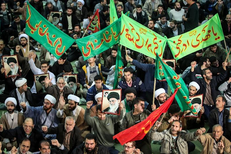 A file picture shows supporters of the Iranian government chanting slogans as they march near Tehran's Imam Khomeini grand mosque on December 30, 2017 (AFP Photo/HAMED MALEKPOUR)