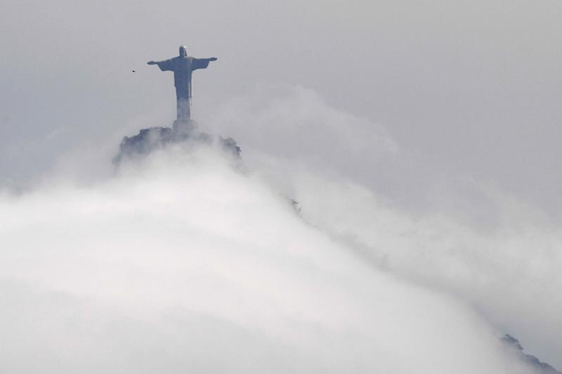 View of the Christ the Redeemer statue, located at the peak of the 700 metre (2,300 ft) Corcovado mountain, taken during the Rio 2016 Olympic Games in Rio de Janeiro on August 9, 2016. (Photo credit: WILLIAM WEST/AFP/Getty Images)