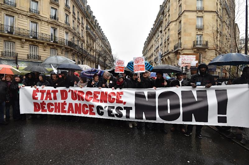 "People holding a banner reading ""State of emergency, deprivation of citizenship, no!"" during a demonstration on January 30, 2016 at the Place de la Republique in Paris (AFP Photo/Alain Jocard)"