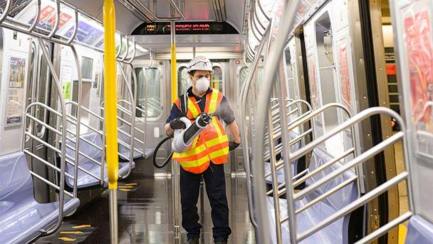PHOTO: In this May 23 ,2020, file photo, an MTA cleaning contractor sprays Shockwave RTU disinfectant inside a New York City subway car on the Upper East Side during the coronavirus pandemic in New York. (Noam Galai/Getty Images, FILE)