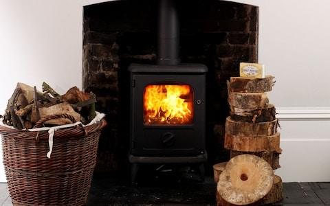 If you can not give up your wood burner make sure you use well seasoned wood - Credit: Clara Molden