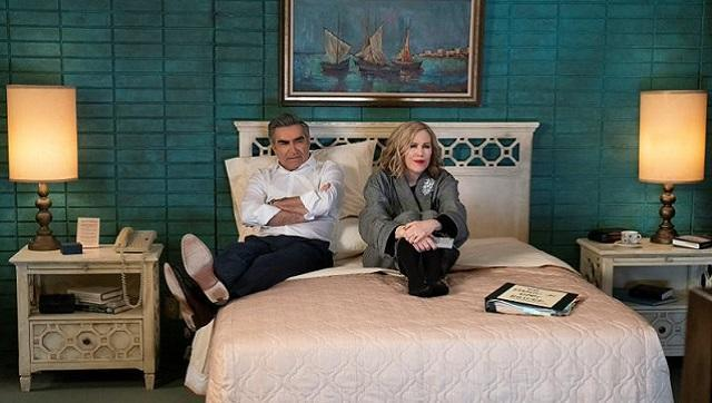 Johnny and Moira Rose in their tacky motel room at Schitt's Creek: the setting is marked by its deliberately ordinary appearance