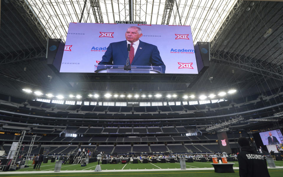 Big 12 commissioner Bob Bowlsby is shown on the giant screen as he speaks during NCAA college football Big 12 media days Wednesday, July 14, 2021, in Arlington, Texas. (AP Photo/LM Otero)