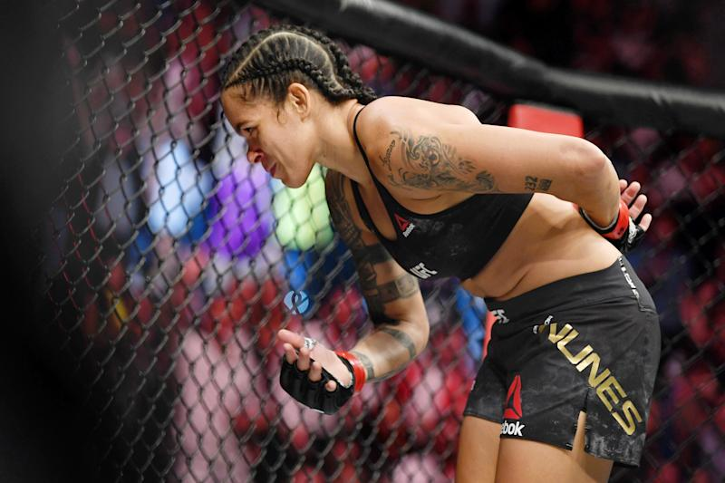 Jul 6, 2019; Las Vegas, NV, USA; Amanda Nunes (red gloves) after her win against Holly Holm (not pictured) at T-Mobile Arena. Mandatory Credit: Stephen R. Sylvanie-USA TODAY Sports