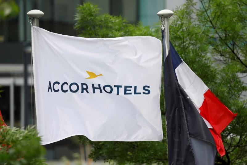 FILE PHOTO: The logo of French hotel operator AccorHotels is seen on a flag pole at the financial and business district of La Defense in Puteaux