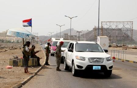 Southern separatist fighters man a checkpoint in Aden